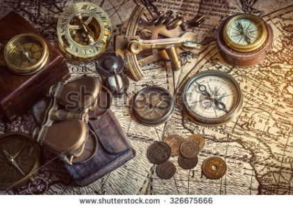 stock-photo-old-compass-astrolabe-on-vintage-map-retro-style-326675666