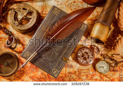 stock-photo-vintage-still-life-magnifying-glass-pocket-watch-old-book-and-goose-quill-pen-lying-on-an-old-329287238